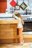 Little girl getting tableware before dinner. Little girl getting tableware from table case before dinner Stock Photo
