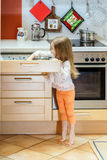 Little girl getting tableware before dinner Royalty Free Stock Image