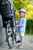 Little girl getting to ride a bicycle Royalty Free Stock Photography