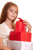 Little girl and gift Stock Images