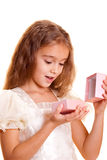 Little girl and gift Stock Image