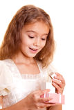 Little girl and gift Royalty Free Stock Image