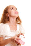 Little girl and gift Royalty Free Stock Images