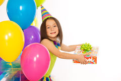 Little girl with gift box and colorful balloons on stock photo