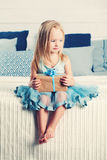 Little Girl with Gift Box. Cute Child at Home Royalty Free Stock Image