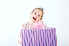 Little girl with gift box Royalty Free Stock Photos