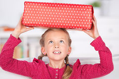 Little Girl With Gift Box On Head Stock Images