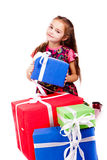 Little girl with gift boxes Stock Photos