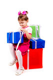 Little girl with gift boxes Royalty Free Stock Photography