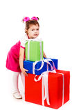 Little girl with gift boxes Royalty Free Stock Photos