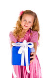 Little girl with gift boxes Stock Image