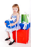 Little girl with gift boxes Stock Photo