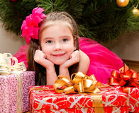 Little girl with gift boxes near christmas tree Stock Photography