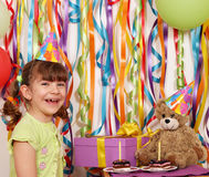 Little girl with gift cakes and teddy bear birthday party Royalty Free Stock Photo