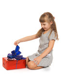 Little girl with a gift Royalty Free Stock Photos