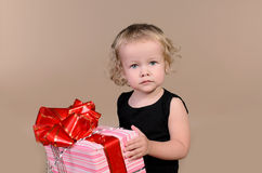 Little girl with gift Royalty Free Stock Photography