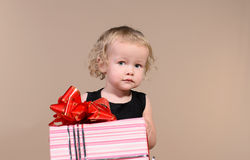Little girl with gift royalty free stock photo