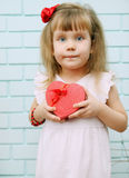 Little  Girl with a gift Royalty Free Stock Photography