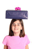 Little girl with a gift on the head Stock Image