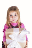 Little girl with a gift Royalty Free Stock Images