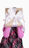 Little girl with a gift Royalty Free Stock Image