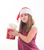 Little girl with a gift in a Santa hat. Girl teenager with a gift in a Santa hat Stock Photo