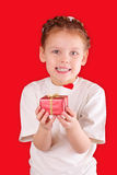 Little girl with a gift for Valentine's Day Stock Photos
