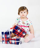 The little girl with gifts Stock Photo