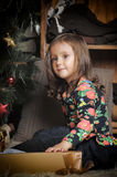 Little girl with gifts near a Christmas tree Royalty Free Stock Photo