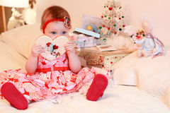 Little girl with a gifts Royalty Free Stock Photography
