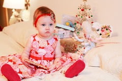 Little girl with a gifts Stock Photography