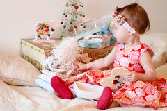 Little girl with a gifts Stock Photos