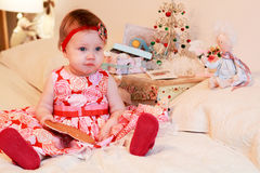 Little girl with a gifts Stock Images