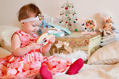 Little girl with a gifts Royalty Free Stock Images