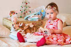 Little girl with a gifts Stock Photo