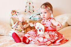 Little girl with a gifts Stock Image