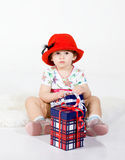The little girl with gifts Royalty Free Stock Photography