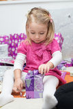 little girl with gifts Stock Image