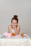 Little girl giggling at tea party Royalty Free Stock Photography
