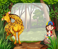 Little girl and giraffe in the woods Stock Photography