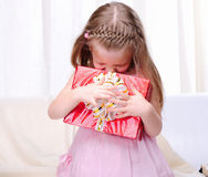 Little girl give a holiday gift Royalty Free Stock Photo