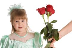The little girl gives a bouquet of roses Stock Image