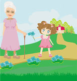 Little girl gives flowers to grandmother Stock Photography