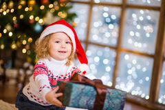 Little girl gives a gift Royalty Free Stock Photo