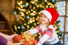 Little girl gives a gift to mum Stock Photography