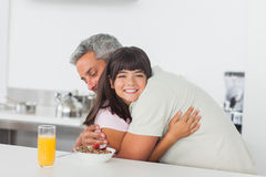 Little girl gives a hug to her father Royalty Free Stock Photos