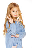 Little Girl Gives a Peace Sign. Little girl posing for the camera with the peace sign Stock Photo