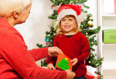 Little girl gives xmas postcard to grandmother Stock Photography