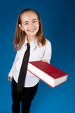 Little girl giving a book Stock Photo
