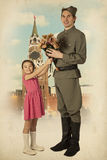 Little girl giving bouquet of flowers to Soviet soldier Stock Image